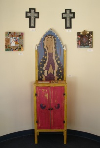 Paula & Greg Snyder's cabinet, flanked by Susanna Baca's mosaics and Blain Anderson's crosses